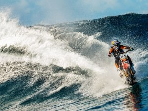 Surfing with a dirt bike !