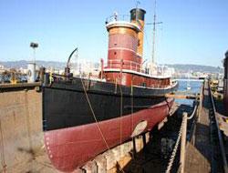 Old tug at dock for repair work