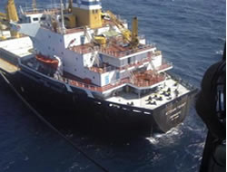 Cargo vessel towed for repairs