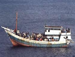 Australian officers rescue boats