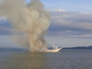 Wooden cargo ship carrying fertilizers caught fire in North Borneo Island
