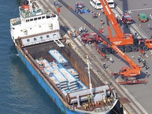 Concrete boards collapsed in cargo ship hold, two dockers trapped beneath, Japan