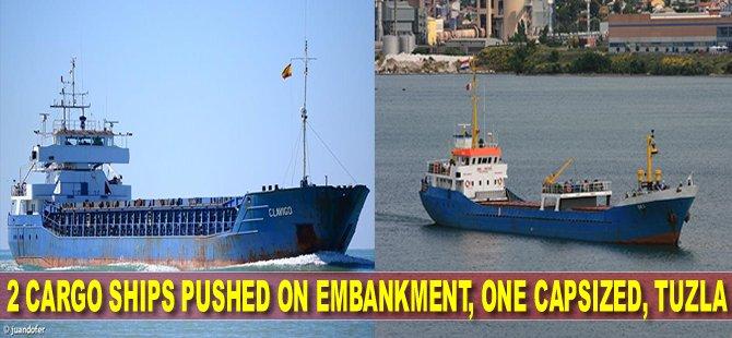 Two cargo ships pushed on embankment, one capsized, Tuzla