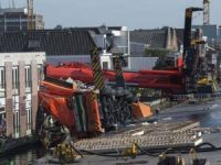 Netherlands crane collapse: One in hospital and 20 feared injured as equipment falls on buildings in Alphen aan den Rijn