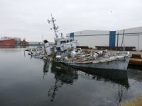 Former HMS bronington, last of the Royal navy's ton-class, sinks next to dock in england
