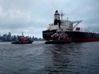 Kinder Morgan Inc. has committed to expanding a pipeline that will allow Canadian crude to be exported to Asia