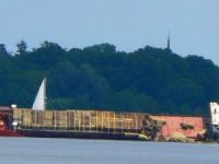 Freighter Lists, Spills Cargo, Then Strikes Dock