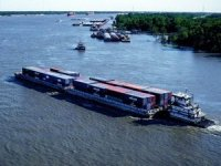 Container on Barge Service Joins Carbon Offset Program