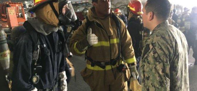 firefighting-teams-make-ready-aboard-uss-bonhomme-richard,-july-12-(usn)-001.JPG