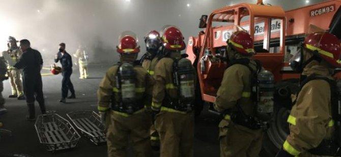 firefighting-teams-make-ready-aboard-uss-bonhomme-richard,-july-12-(usn).JPG