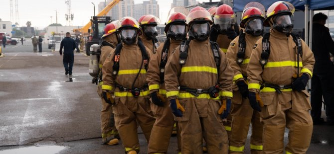 fresh-firefighting-team-stands-ready-on-the-pier,-july-13-(usn).jpg